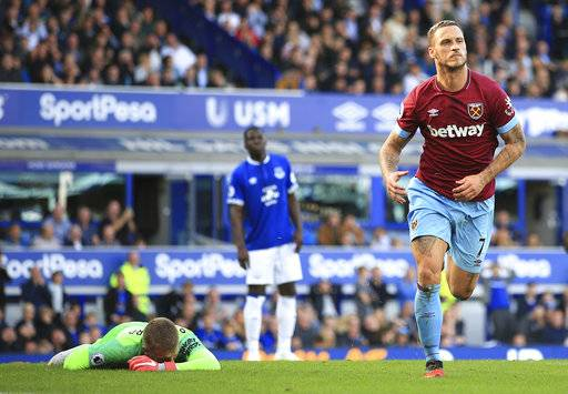 West Ham United's Marko Arnautovic, right, celebrates scoring his side's third goal of the game , during the English Premier League soccer match between Everton and West Ham United, at Goodison Park, Liverpool, England, Sunday Sept. 16, 2018. (Peter Byrne/PA via AP)