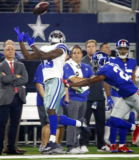 New York Giants cornerback Eli Apple (24) breaks up a pass intended for Dallas Cowboys wide receiver Michael Gallup (13) during the first half of an NFL football game in Arlington, Texas, Sunday, Sept. 16, 2018.