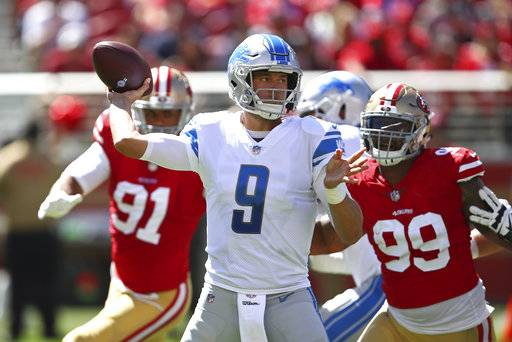 Detroit Lions quarterback Matthew Stafford (9) looks to throw as San Francisco 49ers defensive ends Arik Armstead (91) and DeForest Buckner (99) look on during the first half of an NFL football game in Santa Clara, Calif., Sunday, Sept. 16, 2018.