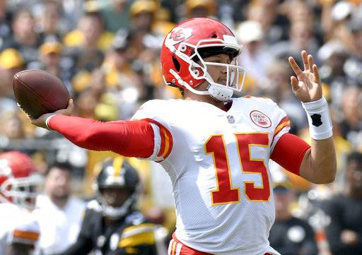Kansas City Chiefs quarterback Patrick Mahomes (15) plays in the first quarter of an NFL football game against the Pittsburgh Steelers, Sunday, Sept. 16, 2018, in Pittsburgh.