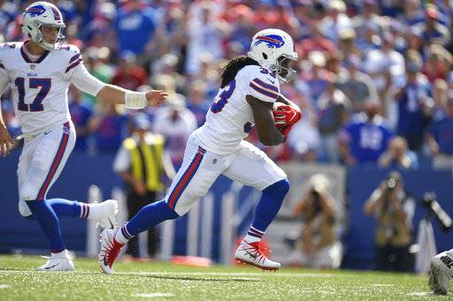 Buffalo Bills' Chris Ivory, right, runs for a touchdown during the second half of an NFL football game against the Los Angeles Chargers, Sunday, Sept. 16, 2018, in Orchard Park, N.Y.