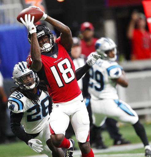 Atlanta Falcons wide receiver Calvin Ridley (18) makes a touchdown catch against Carolina Panthers cornerback Donte Jackson (26) during the first half of an NFL football game, Sunday, Sept. 16, 2018, in Atlanta.