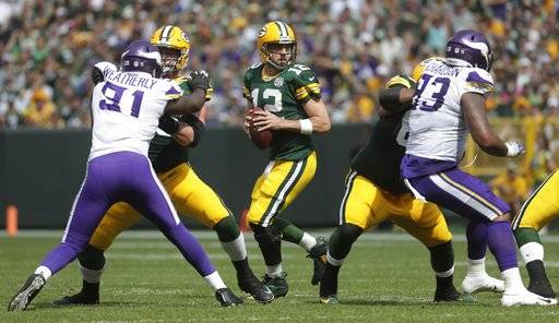 Green Bay Packers' Aaron Rodgers drops back during the first half of an NFL football game against the Minnesota Vikings Sunday, Sept. 16, 2018, in Green Bay, Wis.