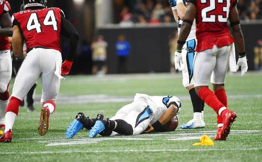 Carolina Panthers quarterback Cam Newton (1) lies on the turf after being hit by Atlanta Falcons cornerback Damontae Kazee (27) during the first half of an NFL football game, Sunday, Sept. 16, 2018, in Atlanta. Kazee was ejected from the game after the hit.