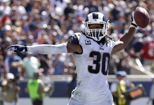 Los Angeles Rams running back Todd Gurley celebrates after scoring during the first half of an NFL football game against the Arizona Cardinals Sunday, Sept. 16, 2018, in Los Angeles.
