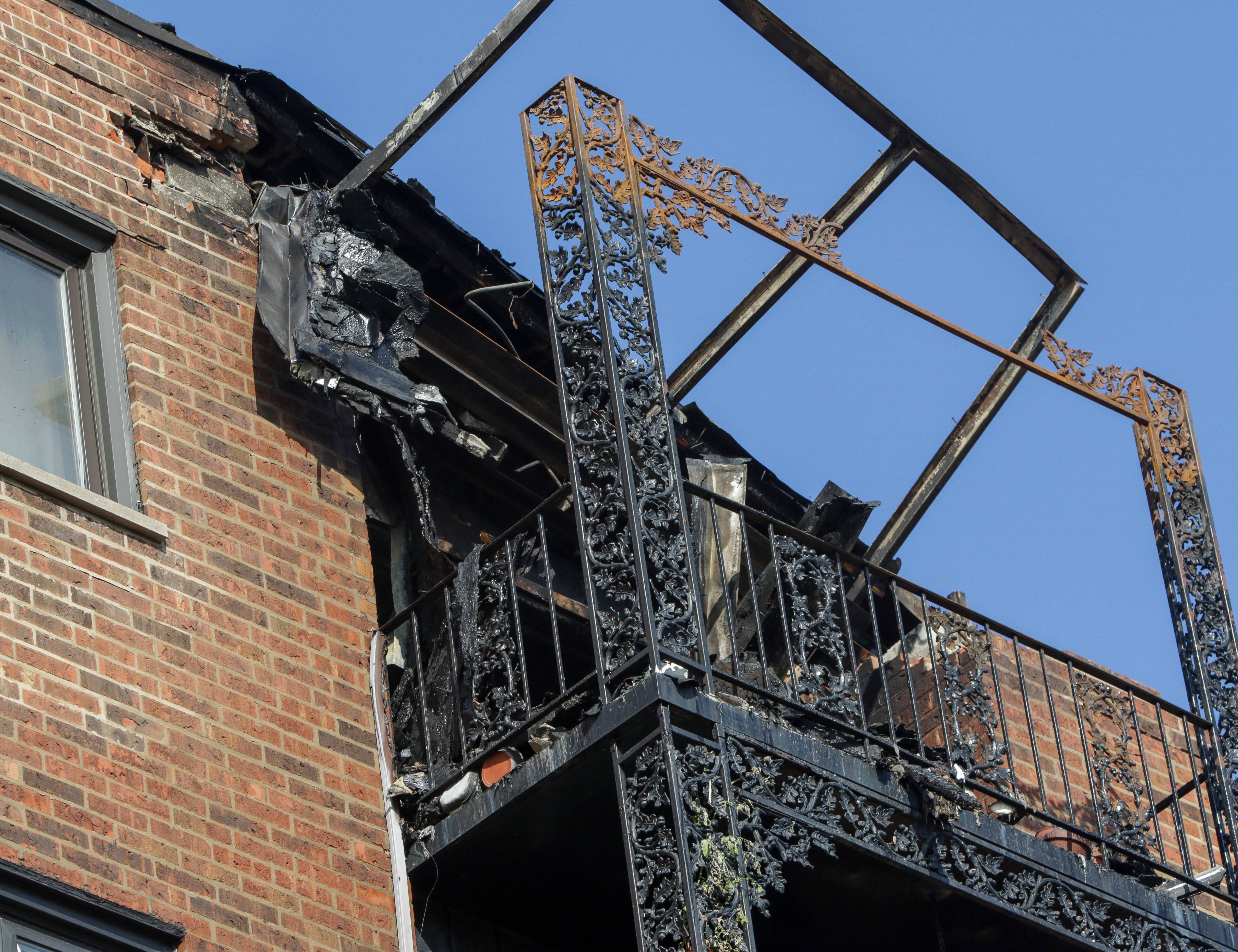 A charred sixth floor balcony shows the aftermath of a fire that ripped through a building Sunday at the Landings condominium complex near Des Plaines. An 85-year-old resident who lived on that floor died in the blaze.