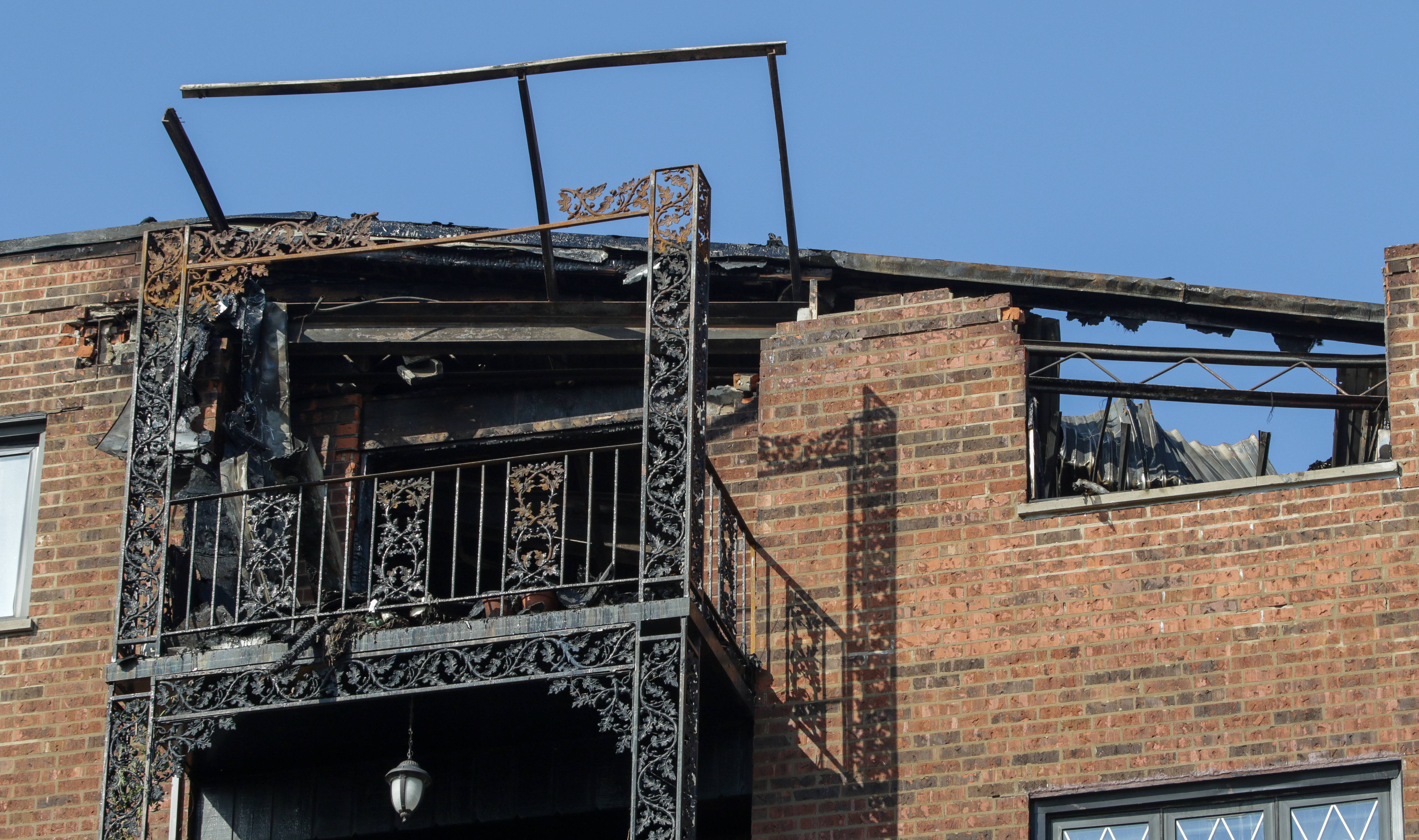 A Sunday morning fire at a condominium building in unincorporated Maine Township left the top corner of the building damaged with a partial roof collapse, missing bricks and a charred interior. But officials said Monday the building may be able to be repaired.