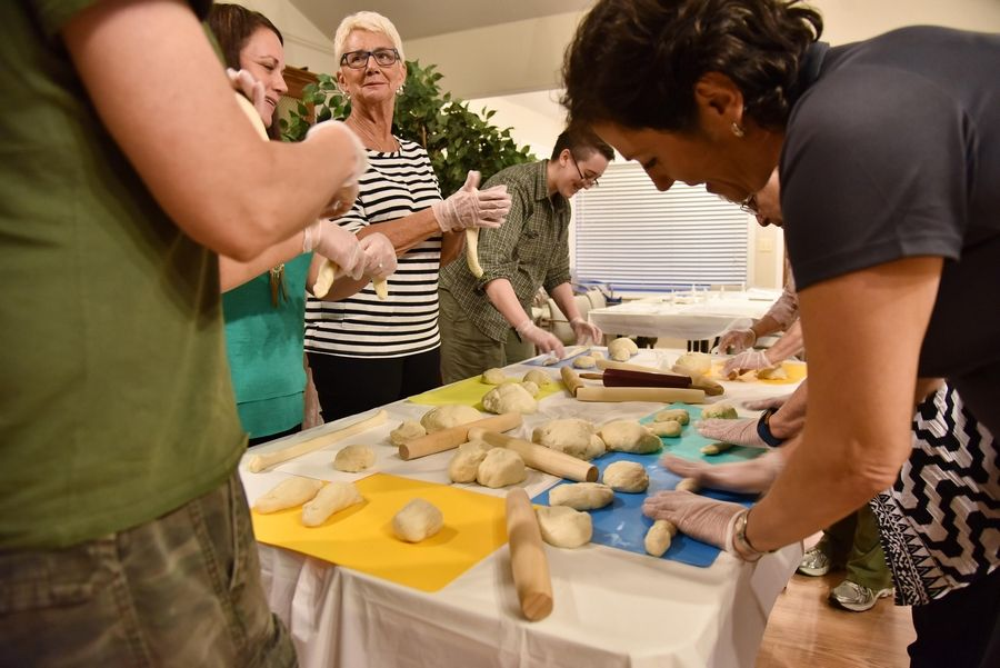 A women's group learns to weave dough for challah bread at the Chabad Jewish Center in Elgin for the Jewish High Holy Days -- Rosh Hashanah and Yom Kippur.