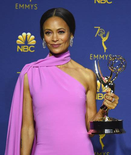 "Thandie Newton, winner of the award for outstanding supporting actress in a drama series for ""Westworld"" poses in the press room at the 70th Primetime Emmy Awards on Monday, Sept. 17, 2018, at the Microsoft Theater in Los Angeles. (Photo by Jordan Strauss/Invision/AP)"