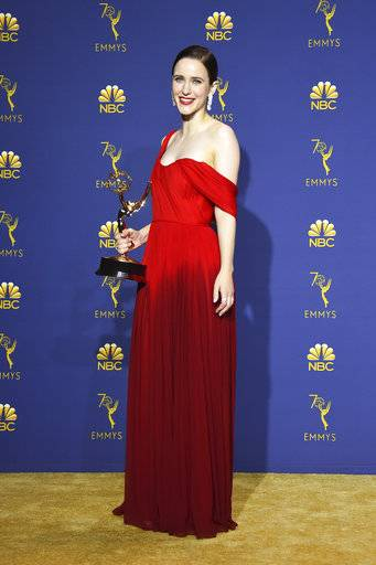 "Rachel Brosnahan, winner of the award for outstanding lead actress in a comedy series for ""The Marvelous Mrs. Maisel,"" poses in the press room at the 70th Primetime Emmy Awards on Monday, Sept. 17, 2018, at the Microsoft Theater in Los Angeles. (Photo by Jordan Strauss/Invision/AP)"