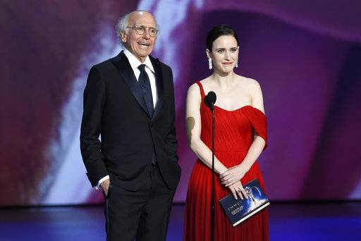 Larry David, left, and Rachel Brosnahan present the award for outstanding lead actor in a limited series, movie or dramatic special at the 70th Primetime Emmy Awards on Monday, Sept. 17, 2018, at the Microsoft Theater in Los Angeles. (Photo by Chris Pizzello/Invision/AP)