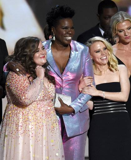 "Issa Rae, from left, Leslie Jones , and Kate McKinnon are seen on stage after winning the award for outstanding variety sketch series for ""Saturday Night Live"" at the 70th Primetime Emmy Awards on Monday, Sept. 17, 2018, at the Microsoft Theater in Los Angeles. (Photo by Chris Pizzello/Invision/AP)"