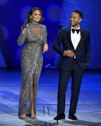 Chrissy Teigen, left, and John Legend present the award for outstanding supporting actress in a limited series, movie or dramatic special at the 70th Primetime Emmy Awards on Monday, Sept. 17, 2018, at the Microsoft Theater in Los Angeles. (Photo by Chris Pizzello/Invision/AP)