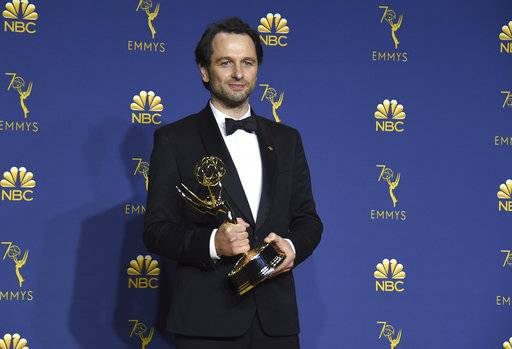 "Matthew Rhys, winner of the award for outstanding lead actor in a drama series for ""The Americans"", poses in the press room at the 70th Primetime Emmy Awards on Monday, Sept. 17, 2018, at the Microsoft Theater in Los Angeles. (Photo by Jordan Strauss/Invision/AP)"