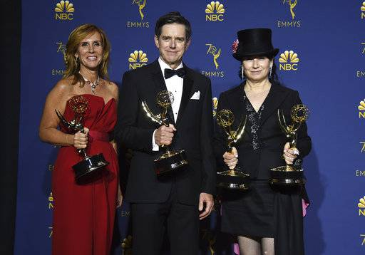 "Sheila Lawrence, from left, Daniel Palladino, and Amy Sherman-Palladino pose in the press room with the award for outstanding comedy series for ""The Marvelous Mrs. Maisel"" at the 70th Primetime Emmy Awards on Monday, Sept. 17, 2018, at the Microsoft Theater in Los Angeles. (Photo by Jordan Strauss/Invision/AP)"