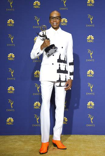 "RuPaul Charles poses in the press room with the award for outstanding reality competition program for ""RuPaul's Drag Race"" at the 70th Primetime Emmy Awards on Monday, Sept. 17, 2018, at the Microsoft Theater in Los Angeles. (Photo by Jordan Strauss/Invision/AP)"