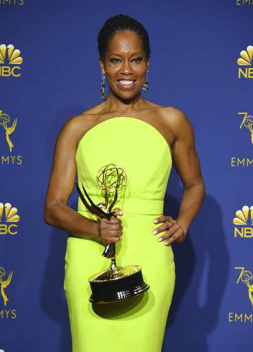 "Regina King, winner of the award for outstanding lead actress in a limited series, movie or dramatic special for ""Seven Seconds"" poses in the press room at the 70th Primetime Emmy Awards on Monday, Sept. 17, 2018, at the Microsoft Theater in Los Angeles. (Photo by Jordan Strauss/Invision/AP)"