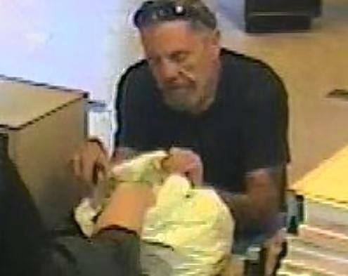 This surveillance photo from the BMO Harris Bank on North Lake Street in Aurora was released by the FBI after it was robbed on Sept. 13. Authorities have charged Lester Bernard, 53, of Aurora in the robbery.