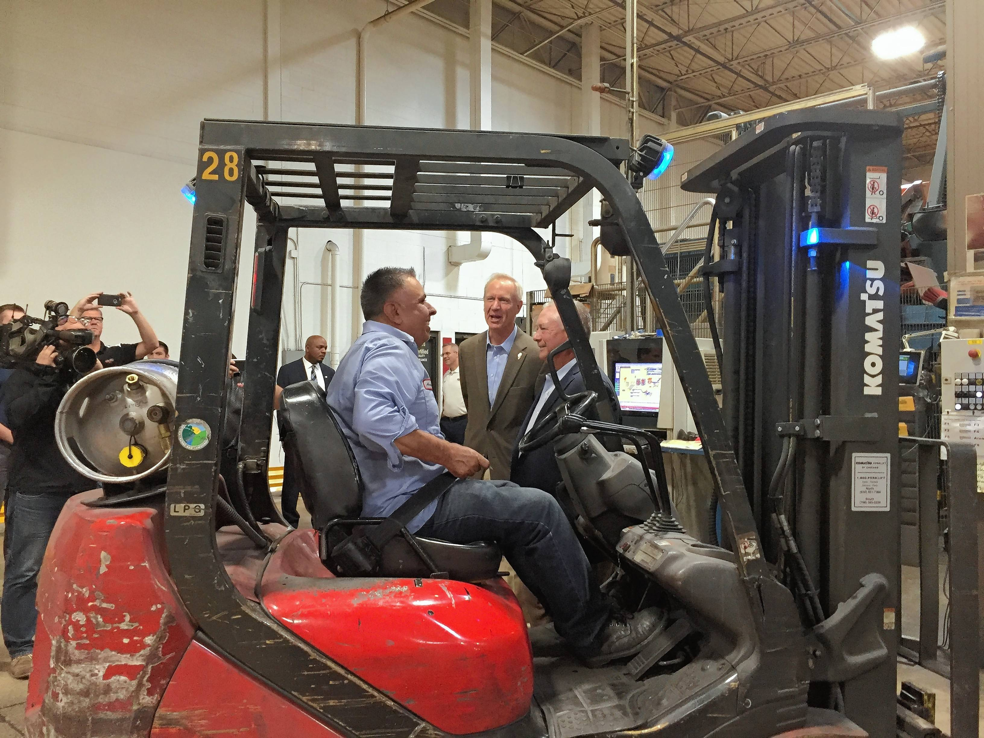 Gov. Bruce Rauner tours SWD Inc. in Addison Tuesday to plug his economic plan. The metal finisher puts protective coatings on screws that go on the outside of cars, among other jobs.