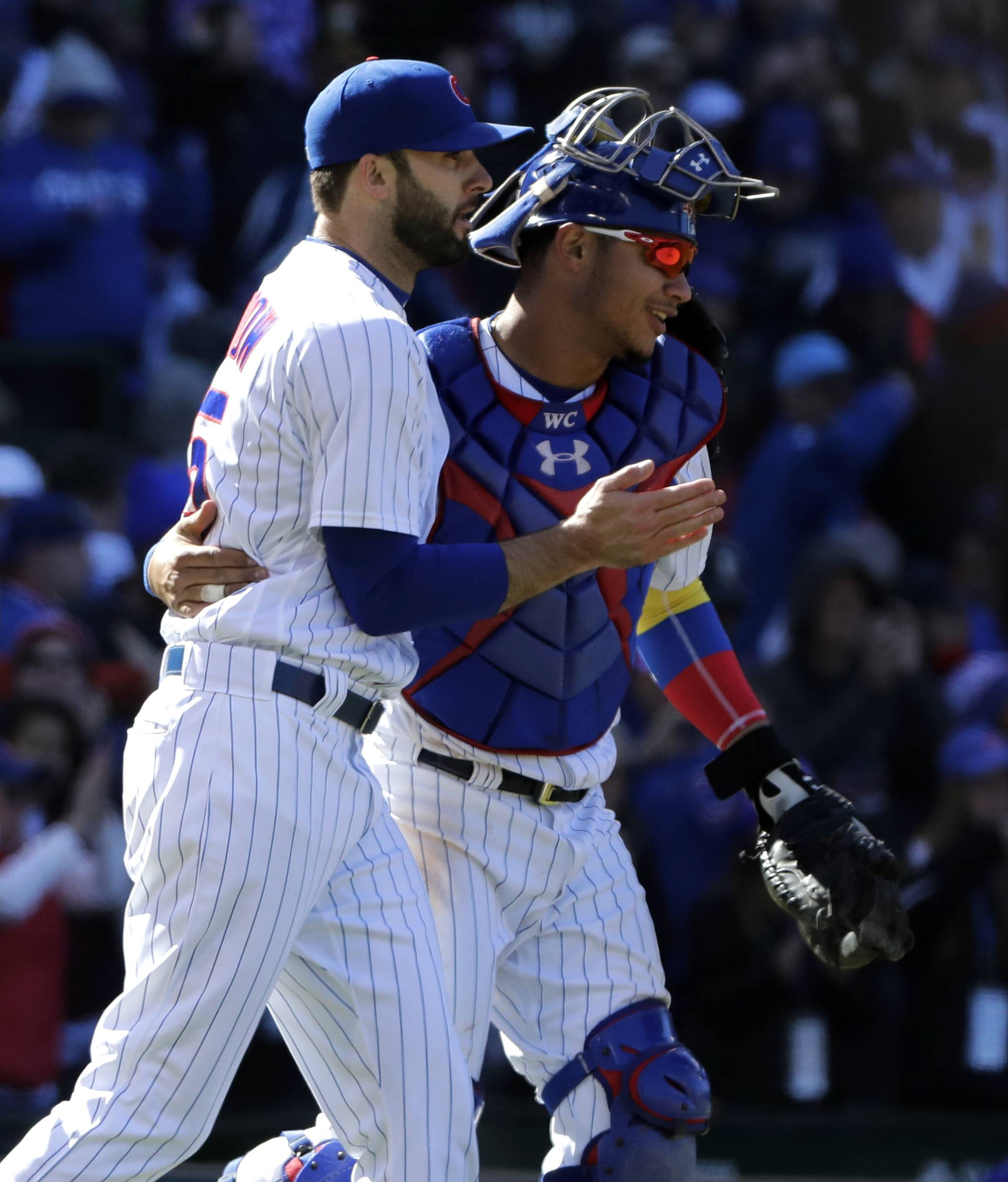 Chicago Cubs closer Brandon Morrow, left, celebrates with catcher Willson Contreras after they defeated the Milwaukee Brewers in a baseball game Sunday, April 29, 2018, in Chicago. (AP Photo/Nam Y. Huh)