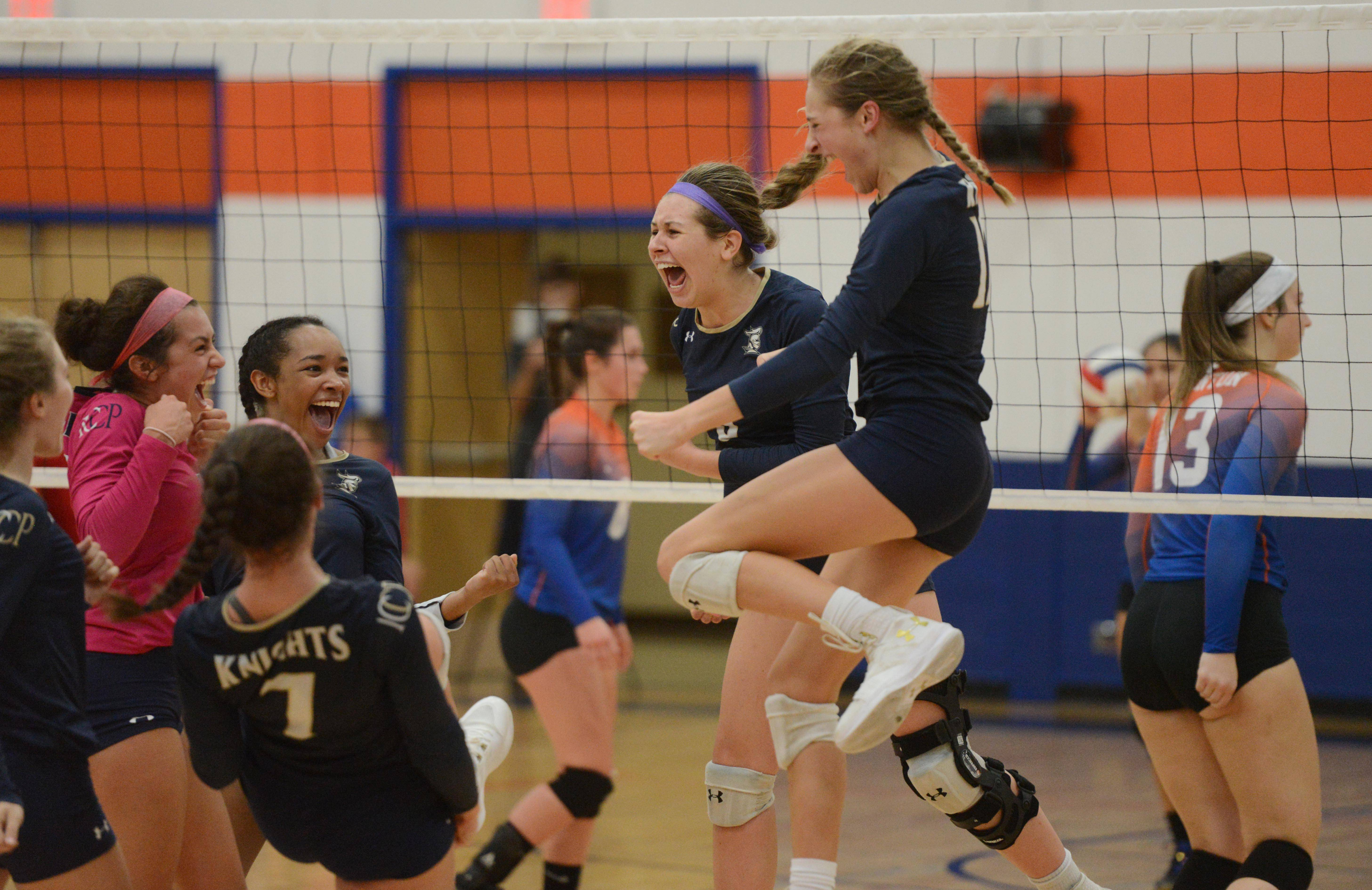 IC Catholic Prep celebrates its victory over Fenton during Tuesday's girls volleyball match in Bensenville.