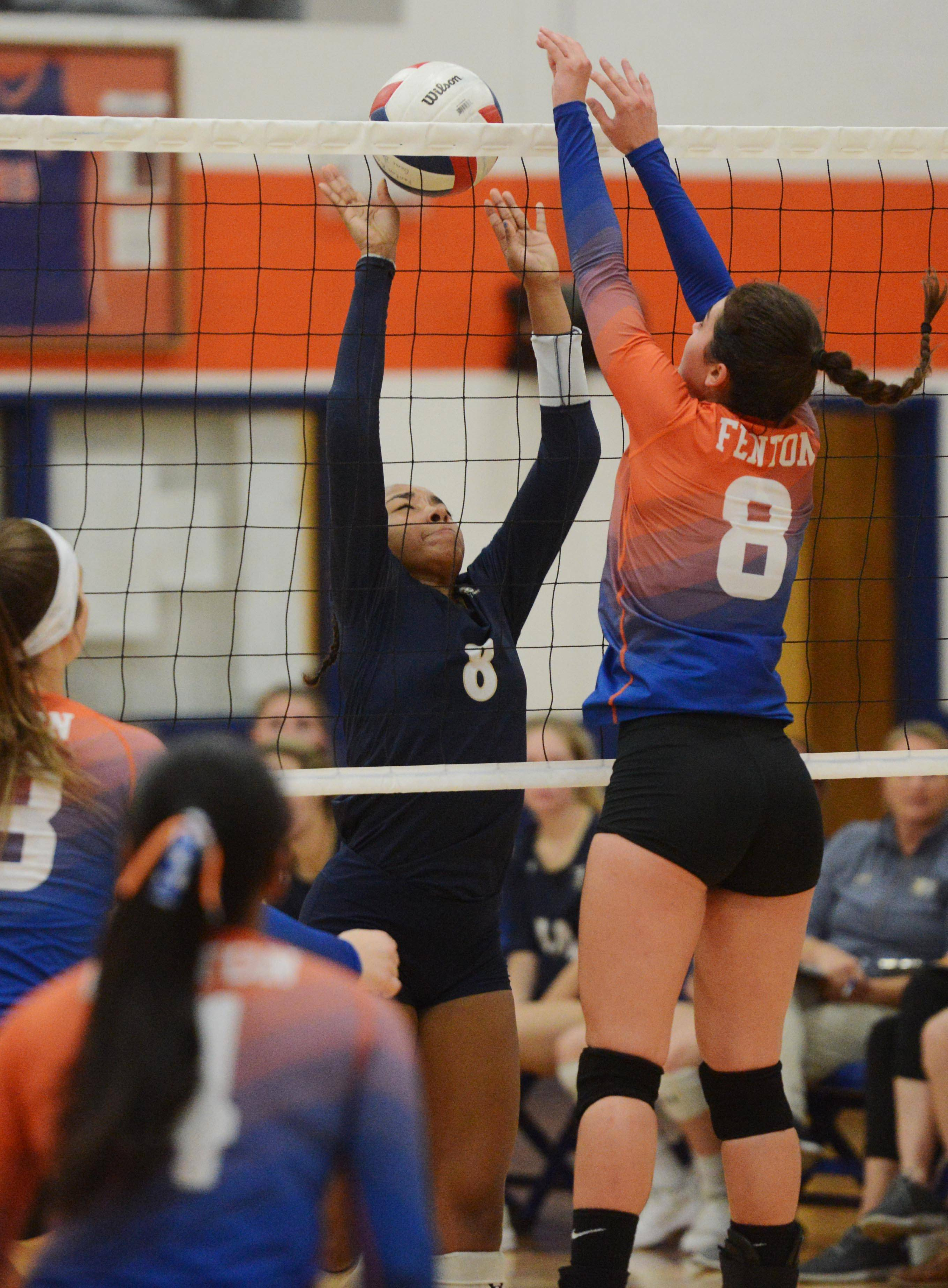 IC Catholic Prep's Maya Stovall, left, and Fenton's Mackenzie Miller battle at the net during Tuesday's girls volleyball match in Bensenville.
