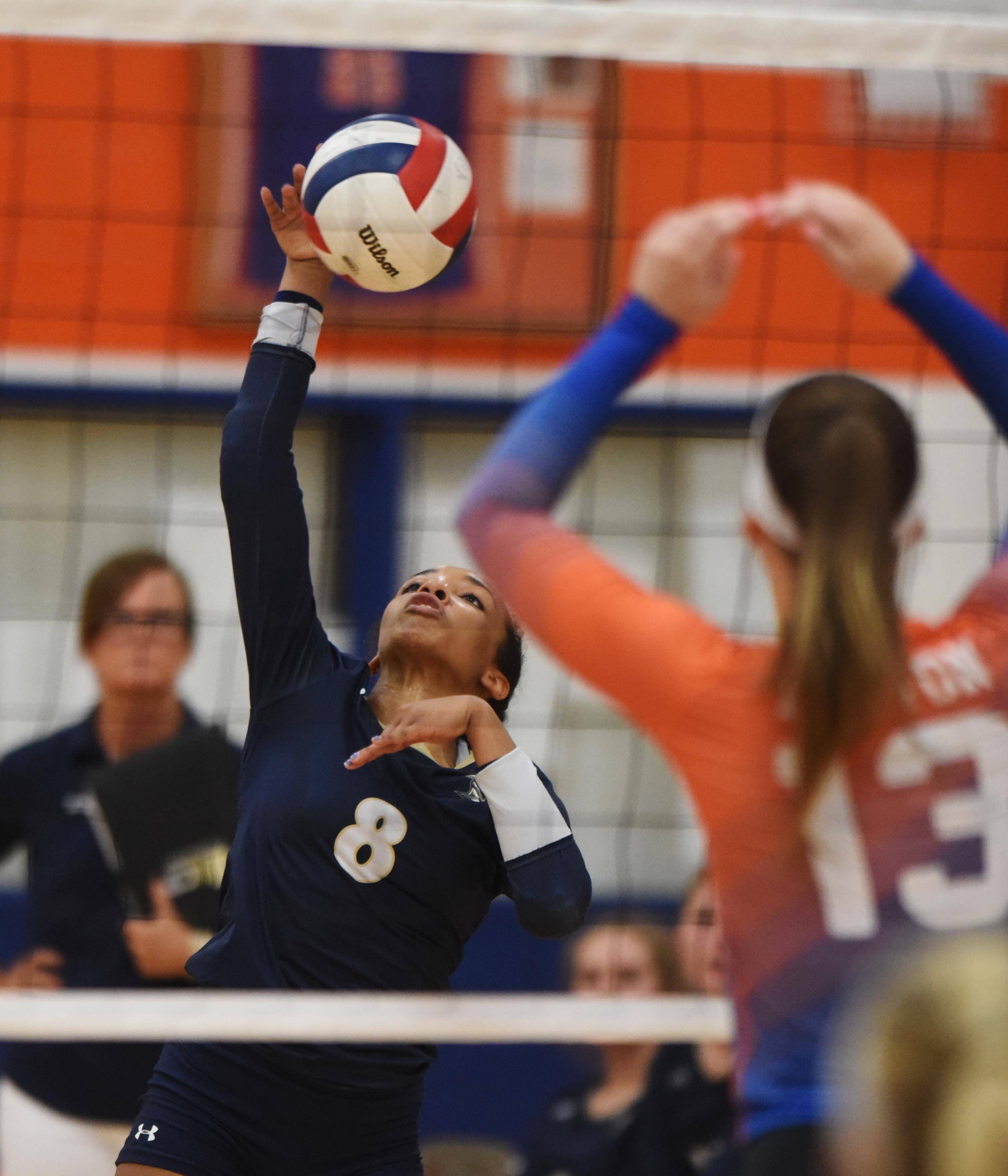 IC Catholic Prep's Maya Stovall hits the ball during Tuesday's girls volleyball match in Bensenville.