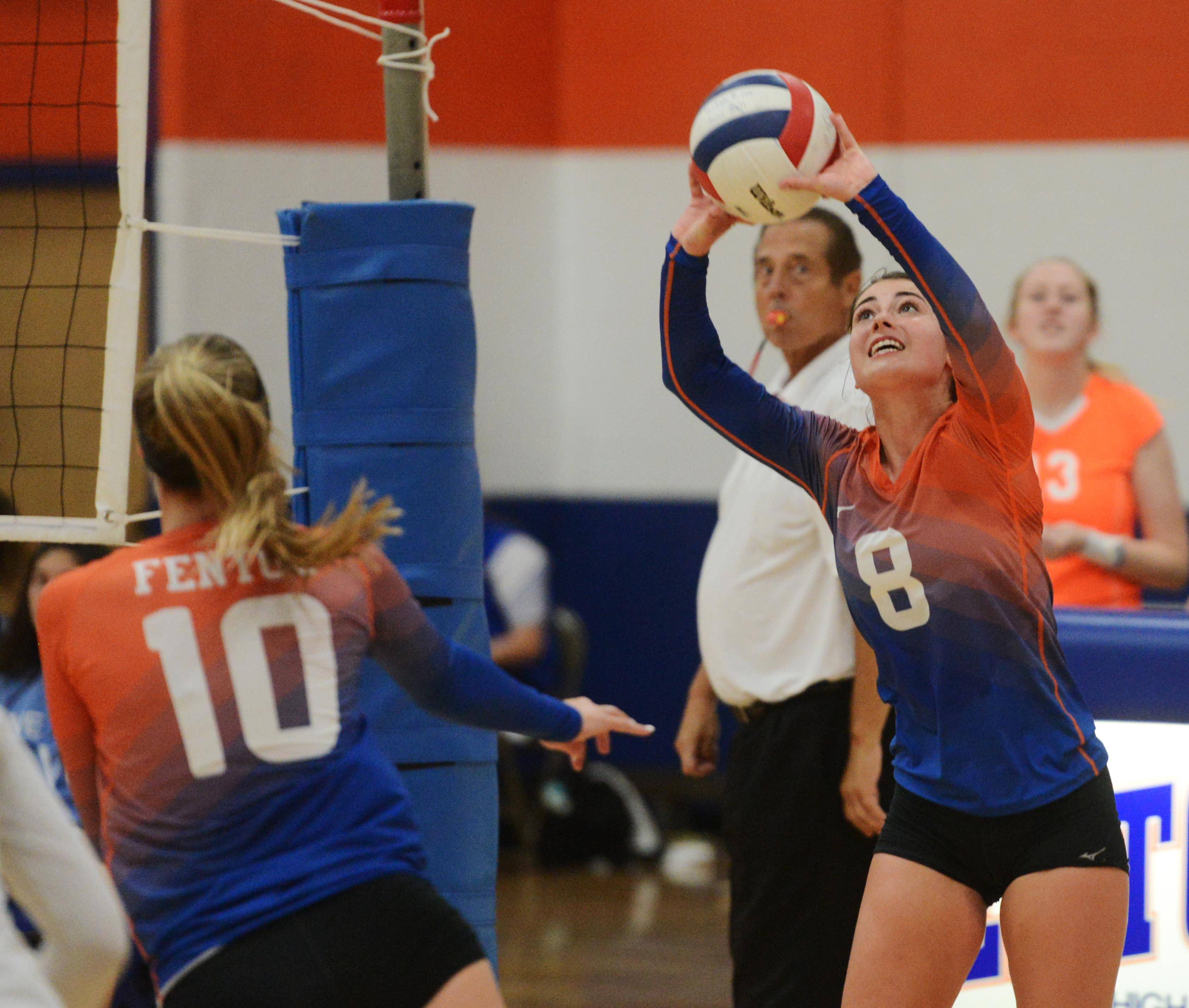 Fenton's Mackenzie Miller sets the ball during Tuesday's girls volleyball match against IC Catholic Prep.