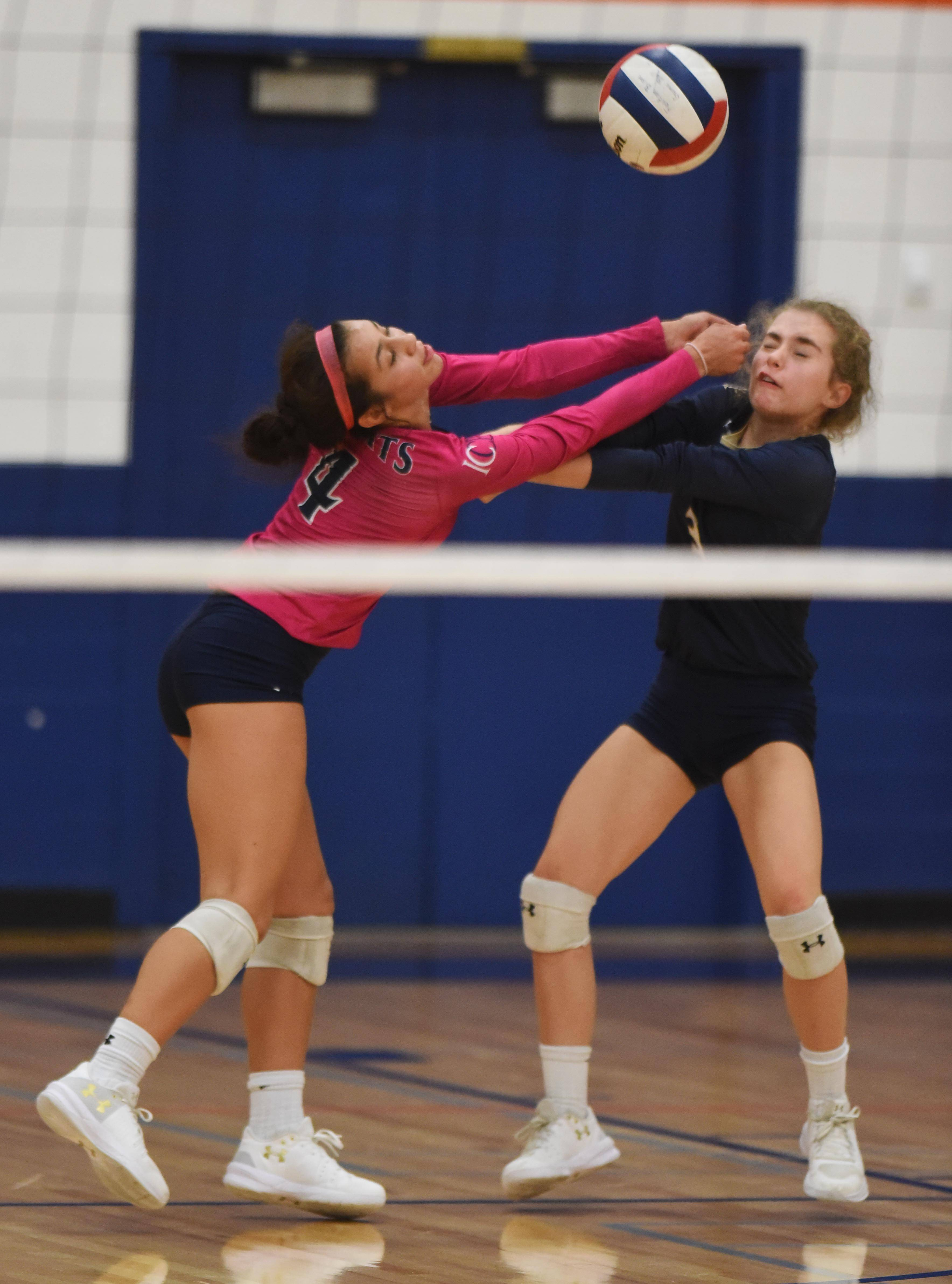 IC Catholic Prep's Isabella Leslie, left, and Morgan Benson converge as they try to keep the ball in play during Tuesday's girls volleyball match against Fenton.
