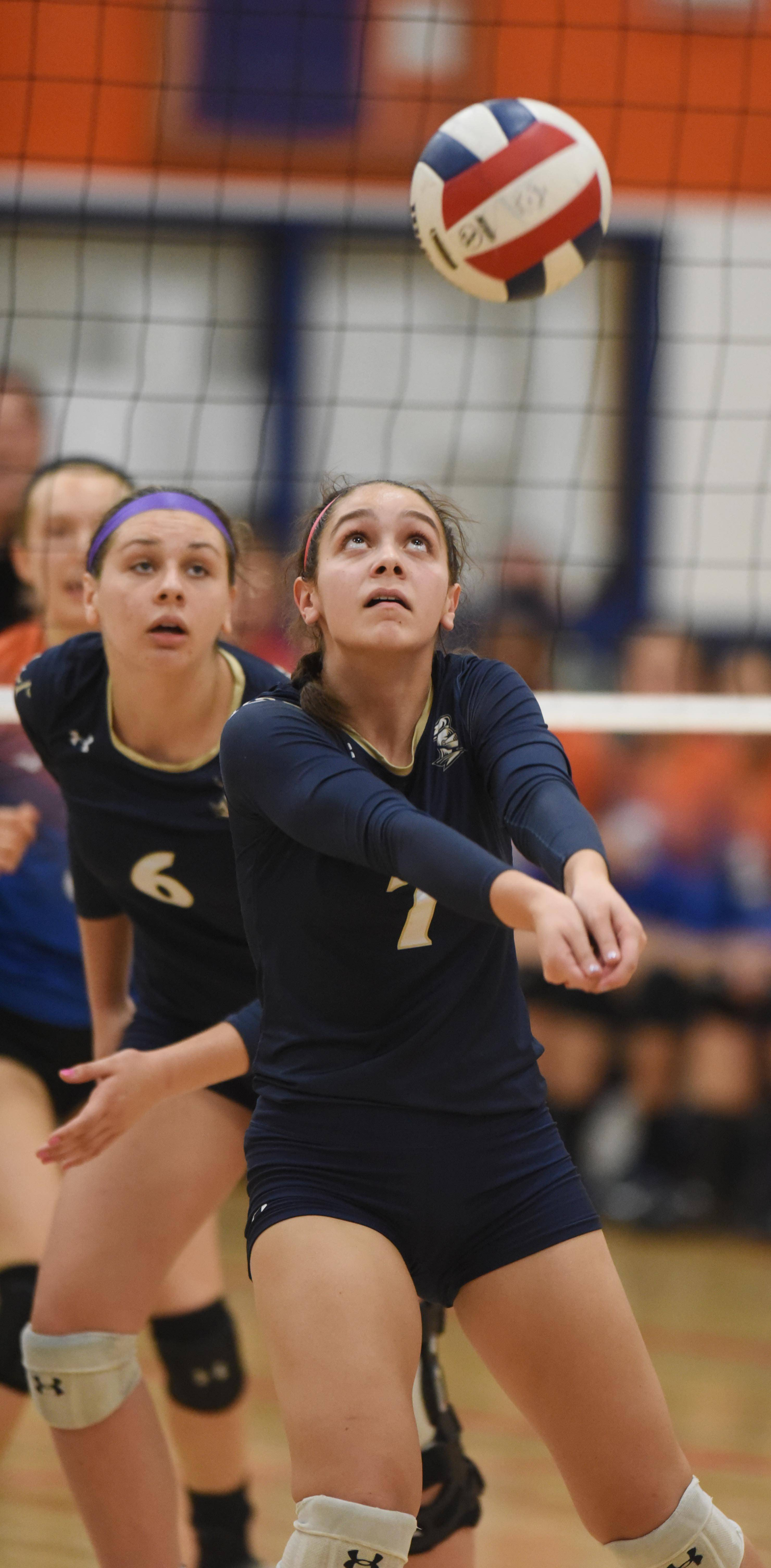 IC Catholic Prep's Sophie Hurt keeps the ball inn play with a dig during Tuesday's girls volleyball match against Fenton.