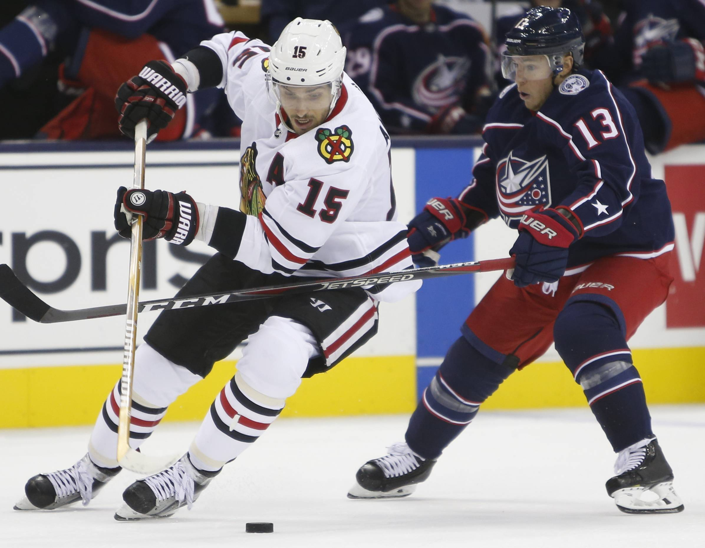 Chicago Blackhawks' Artem Anisimov, left, of Russia, keeps the puck away from Columbus Blue Jackets' Cam Atkinson during the third period of a preseason NHL hockey game Tuesday, Sept. 18, 2018, in Columbus, Ohio. (AP Photo/Jay LaPrete)