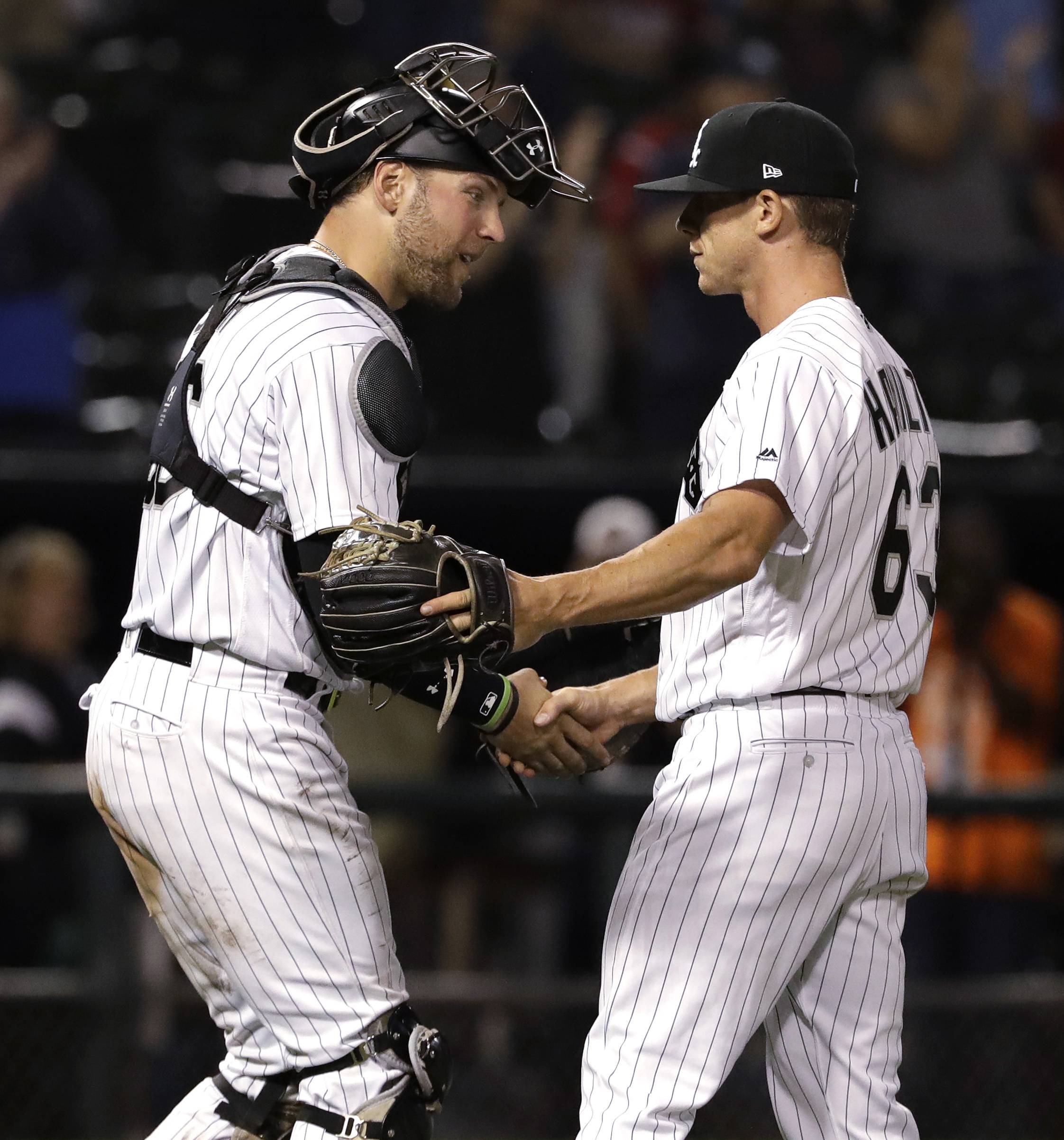 Chicago White Sox relief pitcher Ian Hamilton, right, celebrates with catcher Kevan Smith after the White Sox defeated the Boston Red Sox 6-1 in a baseball game, early Saturday, Sept. 1, 2018, in Chicago. (AP Photo/Nam Y. Huh)