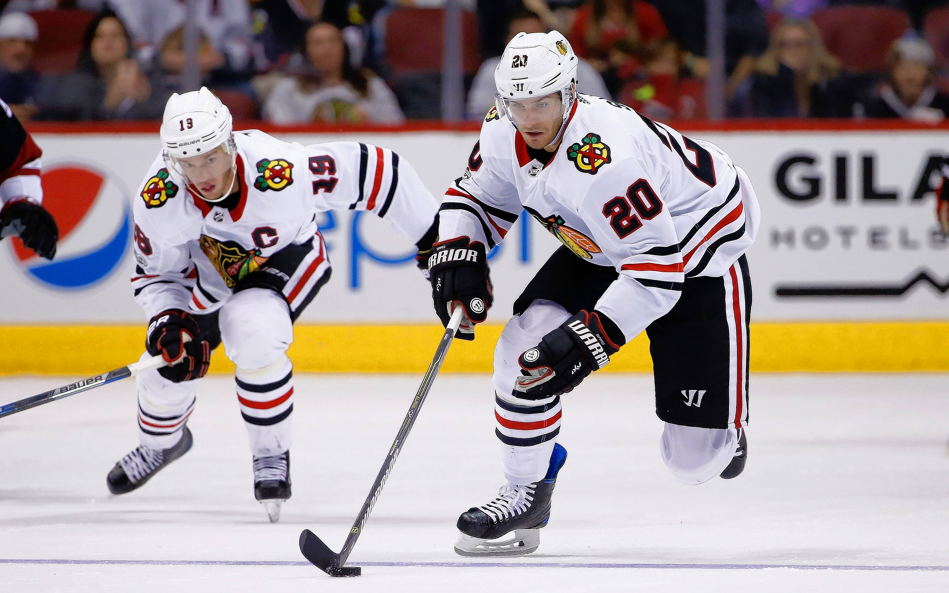 The Blackhawks' Brandon Saad skates with Jonathan Toews against Arizona in a game last year.