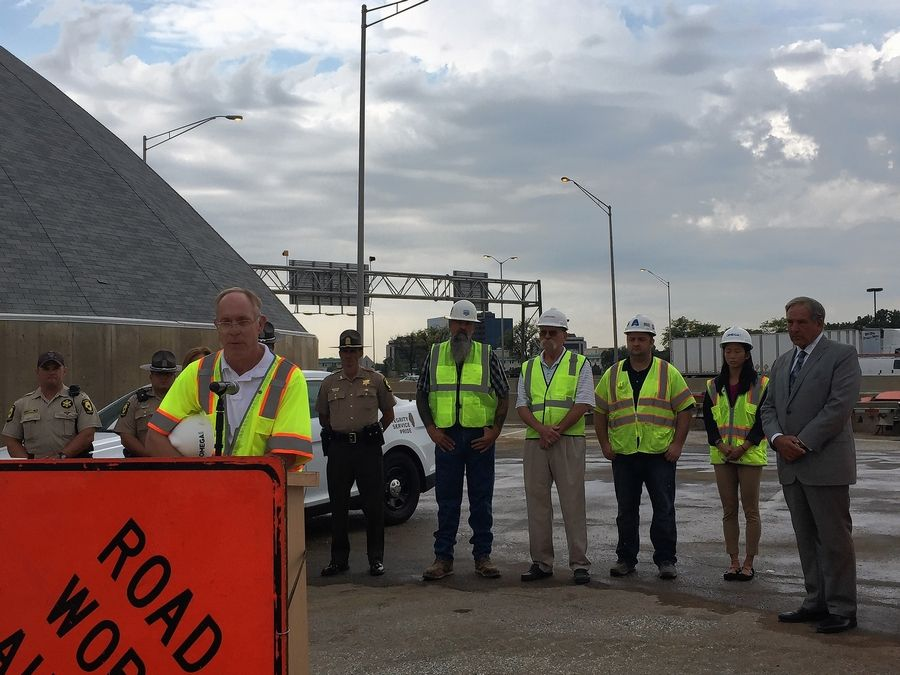 Civil Engineer Michael Wiater recounts a close call in a work zone Tuesday at a news conference as Illinois tollway Chairman Robert Schillerstrom, right, state police and workers listen.
