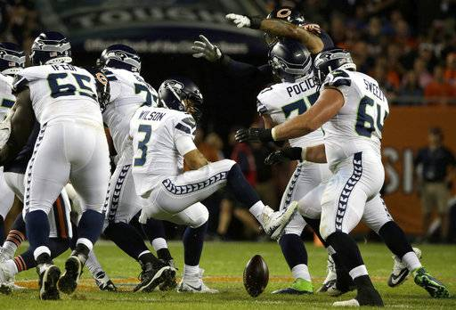 Seattle Seahawks quarterback Russell Wilson (3) loses a ball during the first half of an NFL football game against the Chicago Bears Monday, Sept. 17, 2018, in Chicago.