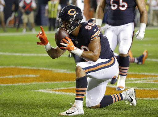 CORRECTS TO TREY BURTON (80) NOT DION SIMS (88) - Chicago Bears tight end Trey Burton (80) celebrates his touchdown during the first half of an NFL football game against the Seattle Seahawks, Monday, Sept. 17, 2018, in Chicago.