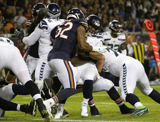 Chicago Bears linebacker Khalil Mack sacks Seattle Seahawks quarterback Russell Wilson (3) during the first half of an NFL football game Monday, Sept. 17, 2018, in Chicago.