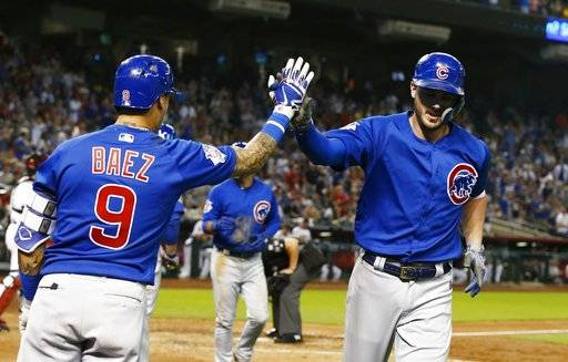 Chicago Cubs' Kris Bryant, right, celebrates his home run against the Arizona Diamondbacks with Javier Baez (9) during the eighth inning of a baseball game, Monday, Sept. 17, 2018, in Phoenix. The Cubs defeated the Diamondbacks 5-1.