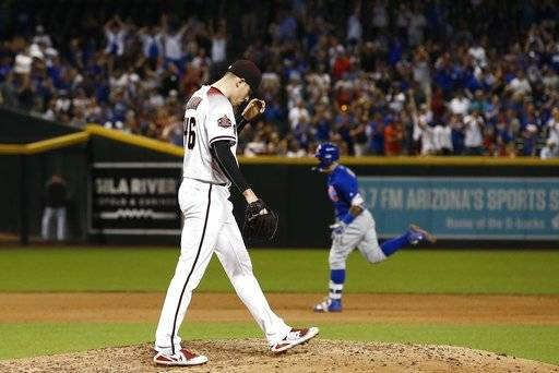 Arizona Diamondbacks starting pitcher Patrick Corbin (46) pauses on the mound after giving up a two-run home run to Chicago Cubs' Javier Baez, right, during the sixth inning of a baseball game Monday, Sept. 17, 2018, in Phoenix.