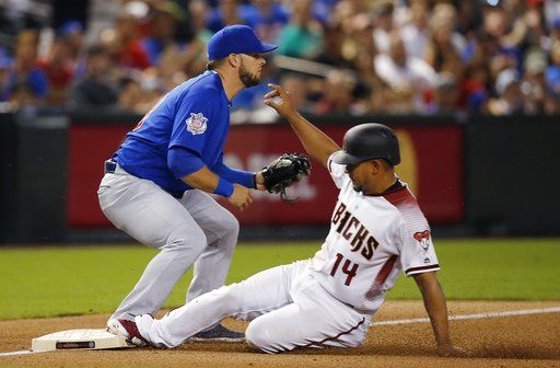 Arizona Diamondbacks' Eduardo Escobar (14) slides safely into third base after tagging up on a fly ball out as Chicago Cubs third baseman David Bote, left, waits for a late throw during the fourth inning of a baseball game Monday, Sept. 17, 2018, in Phoenix.