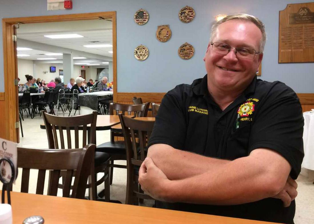 McHenry VFW Post 4600 Cmdr. Dwane Lungren enjoys a break Wednesday after the mayhem of the long-running Queen of Hearts raffle, which ended Tuesday night.