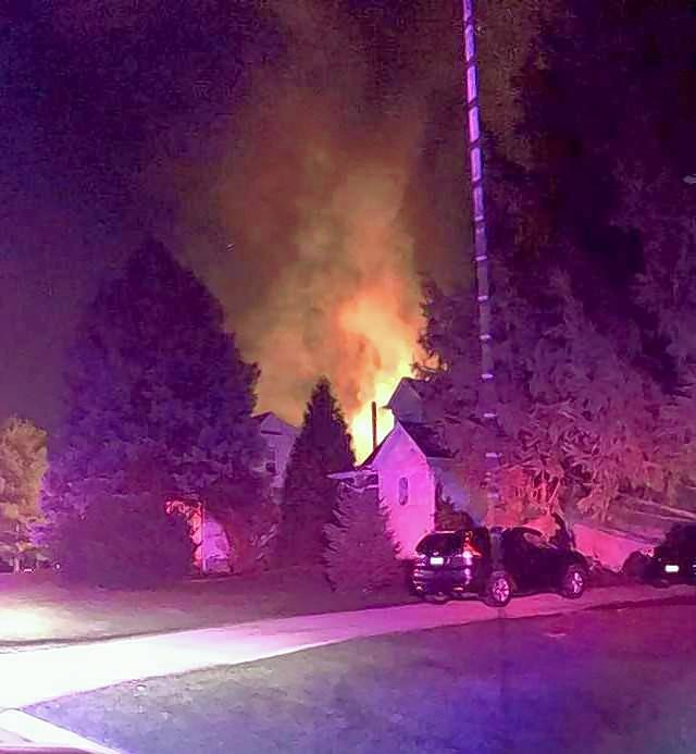 A fire Tuesday night in a detached garage on the 200 block of North Edgewood Avenue in Lombard created a tall plume of flames and smoke. But firefighters confined the blaze to the garage and no one was injured.