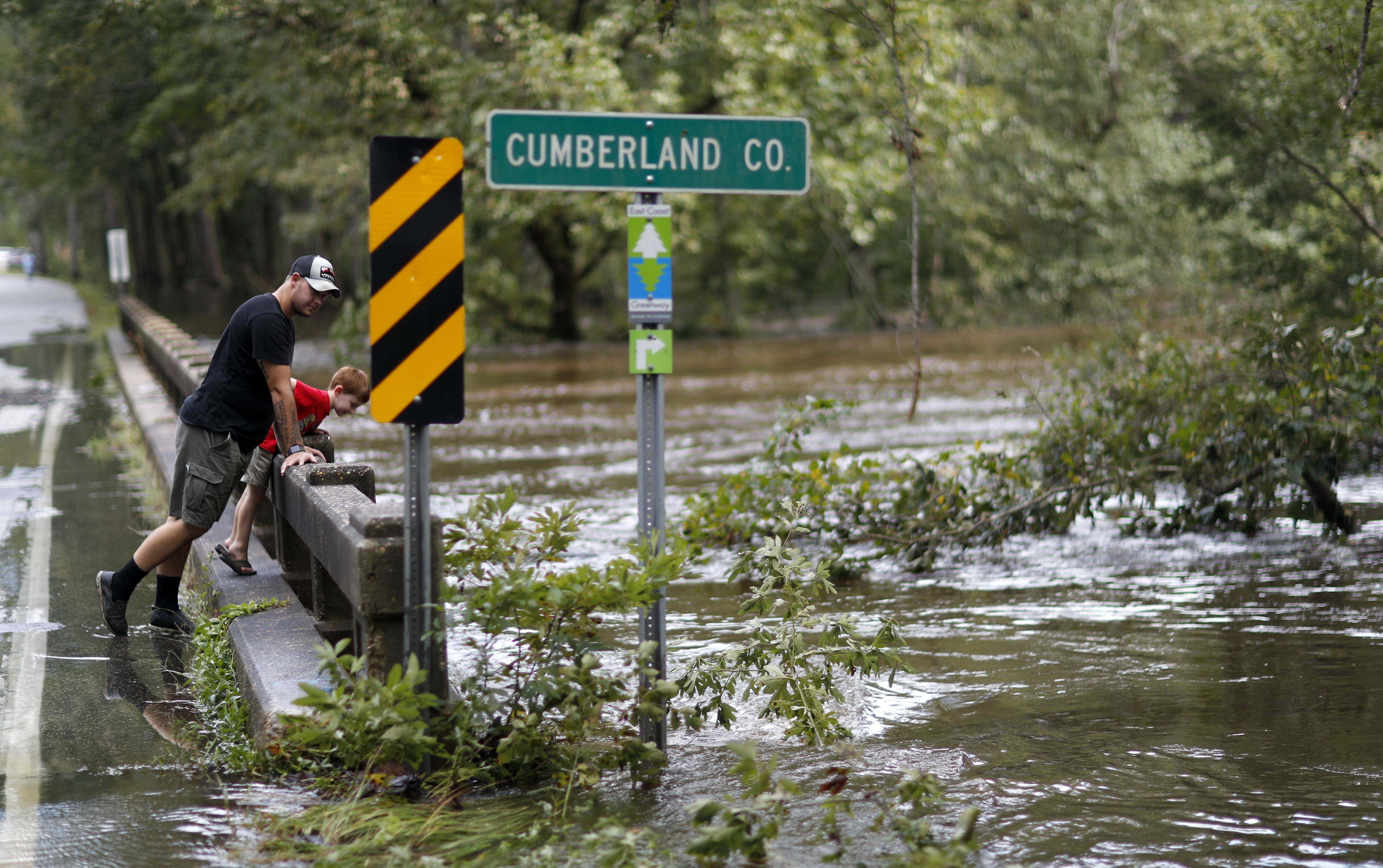 The waters of the Little River flow up against a bridge as it begins to recede making the road passable in the aftermath of Hurricane Florence in Fayetteville, N.C., Tuesday, Sept. 18, 2018. (AP Photo/David Goldman)