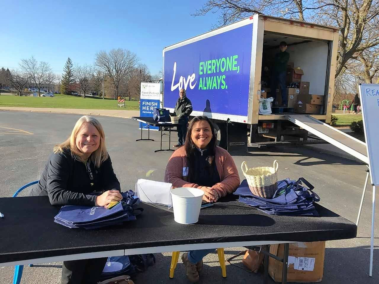 Willow Creek Care Center members Nancy Hatcher and Nancy Garcia wait to meet families at the mobile food pantry.