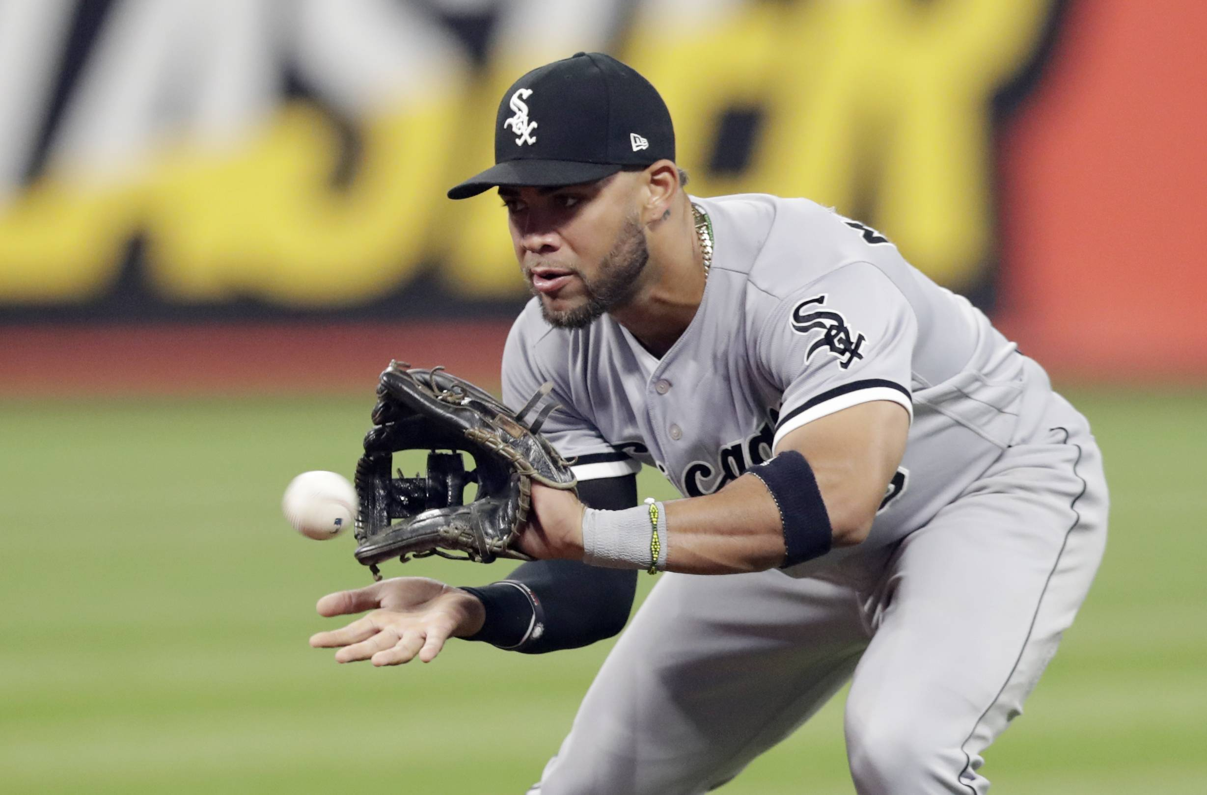 Chicago White Sox's Yoan Moncada fields a ball hit by Cleveland Indians' Melky Cabrera in the fourth inning of a baseball game, Wednesday, Sept. 19, 2018, in Cleveland. Cabrera was out on the play. (AP Photo/Tony Dejak)