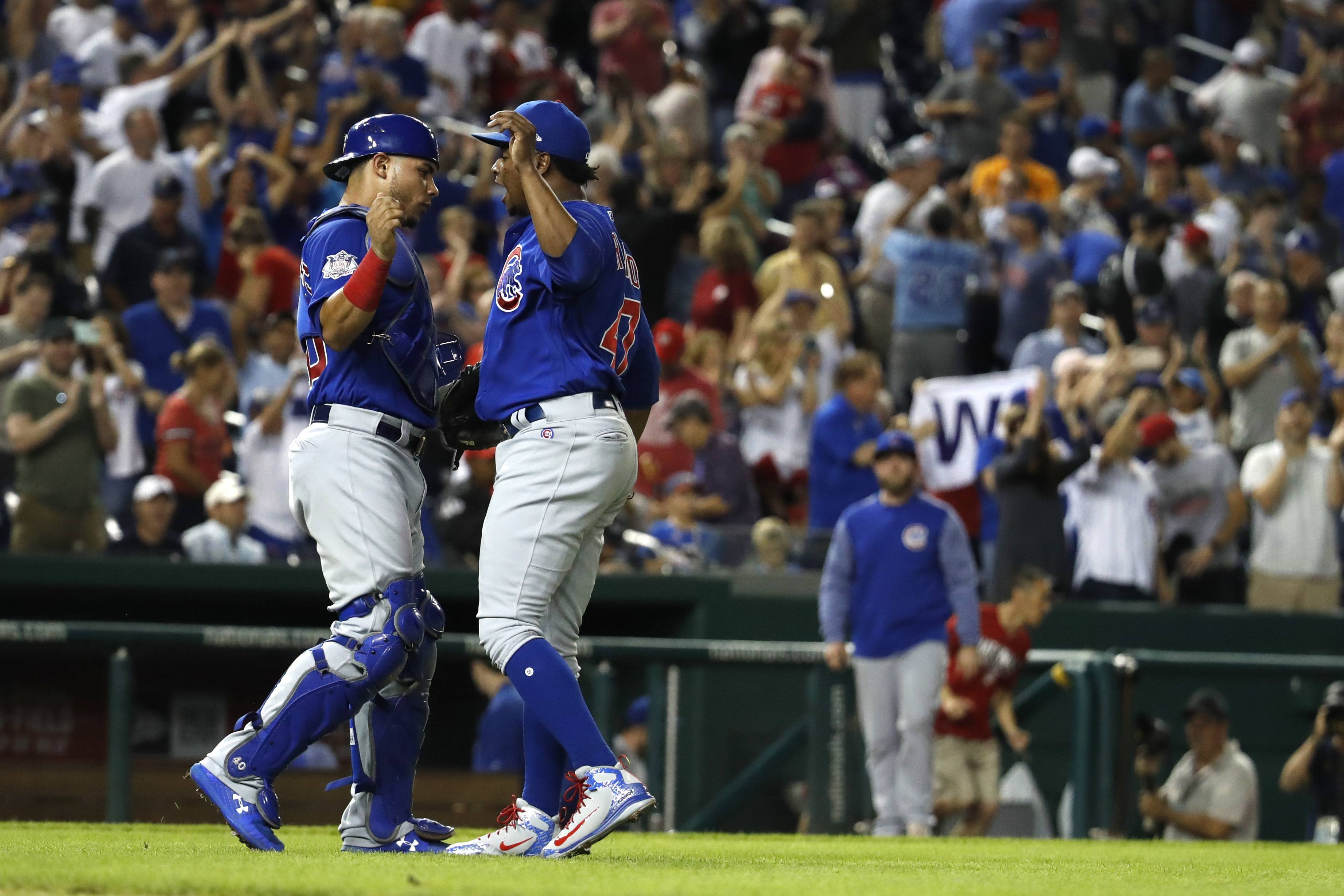 Chicago Cubs catcher Victor Caratini (7) and relief pitcher Randy Rosario (47) celebrate after winning a baseball game in 10 innings against the Washington Nationals, Thursday, Sept. 13, 2018, at Nationals Park in Washington. (AP Photo/Jacquelyn Martin)