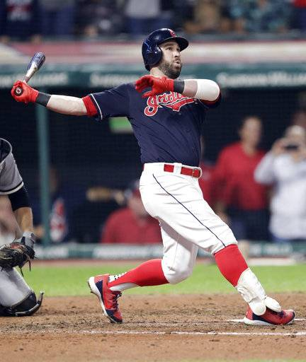 Cleveland Indians' Jason Kipnis watches his ball after hitting a game-winning grand slam off Chicago White Sox relief pitcher Ian Hamilton in the ninth inning of a baseball game, Wednesday, Sept. 19, 2018, in Cleveland. Rajai Davis, Yan Gomes and Greg Allen scored on the play. The Indians won 4-1. (AP Photo/Tony Dejak)