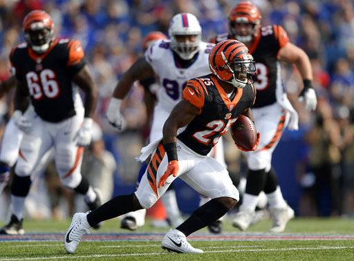 FILE - In this Aug. 26, 2018, file photo, Cincinnati Bengals running back Giovani Bernard carries the ball during the first half of a preseason NFL football game against the Buffalo Bills, in Orchard Park, N.Y. The Bengals will rely more heavily on Giovani Bernard to pull them through the next few games with running back Joe Mixon sidelined after a knee procedure.(AP Photo/Adrian Kraus, File)