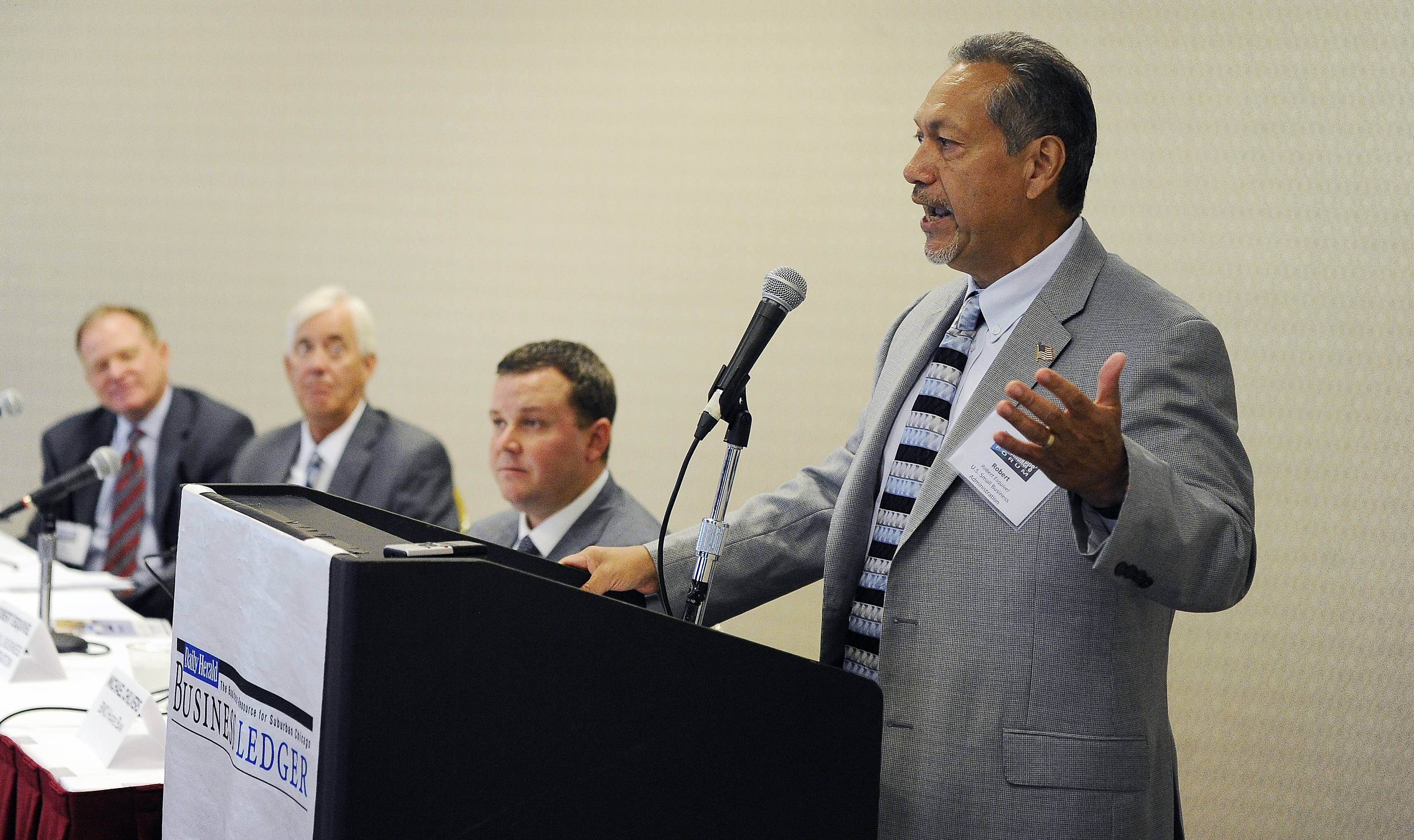 Robert Esquivel, supervisory lender relations specialist, U.S. Small Business Administration in the Illinois District Office, talks to others business leaders at the Daily Herald Business Ledger Newsmakers Forum in Lisle on Thursday.