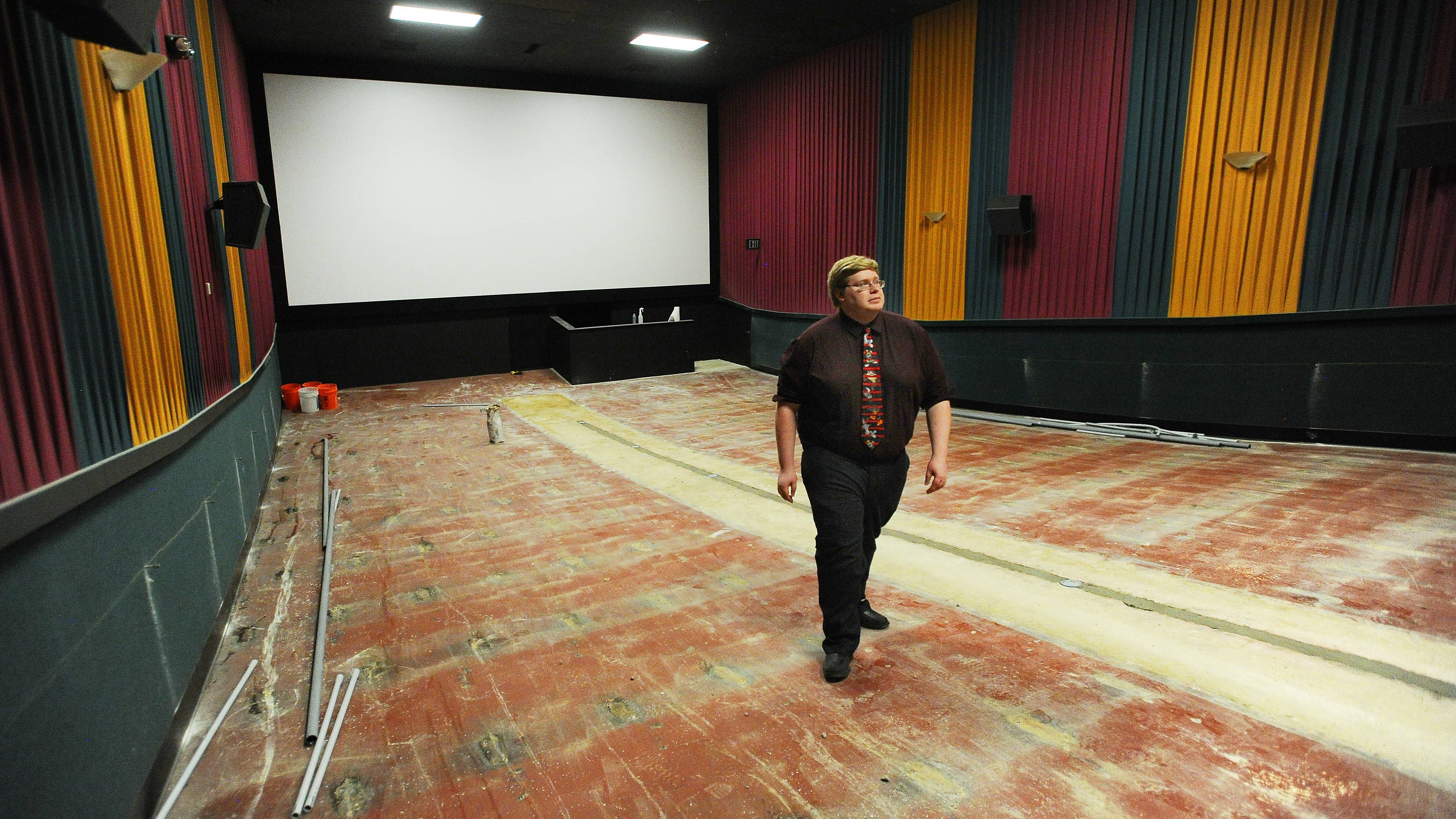 General Manager Andy Dvorak of Ogden 6 theaters in Naperville checks out one of the unfinished theaters that will host new heated reclining chairs to watch first-run movies.